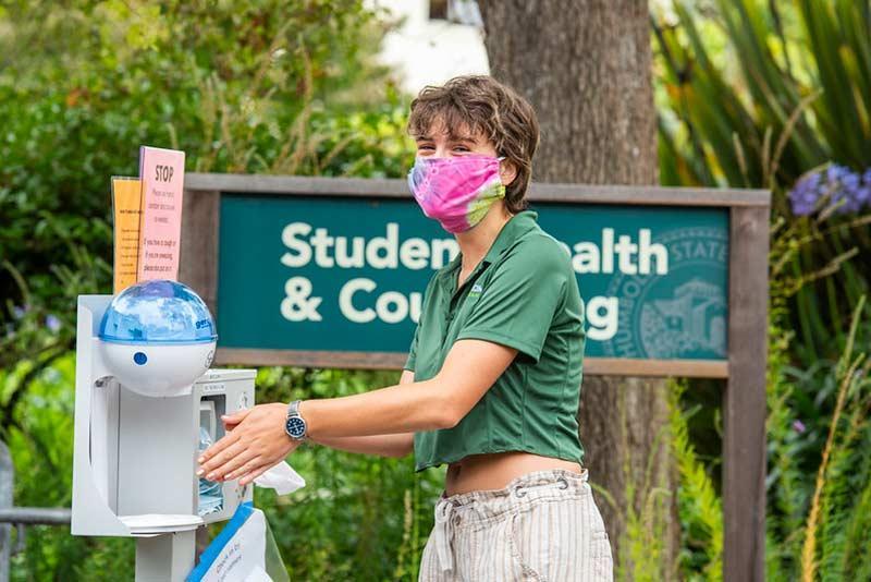Student outside Health Center